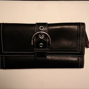 Coach black leather twofold wallet .